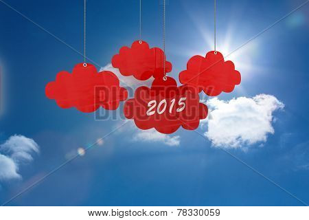 2015 red cloud tags against bright blue sky with clouds