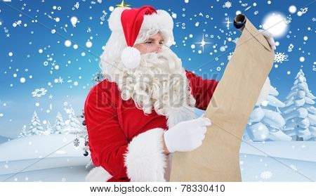 Santa checking list against christmas tree in snowy landscape