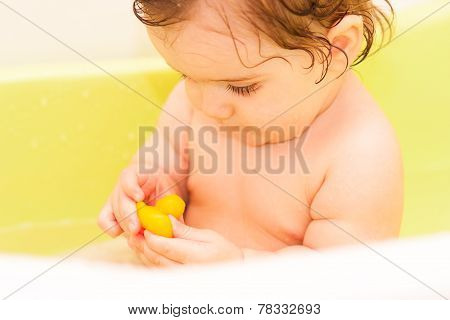 Small Child Sitting In The Bath