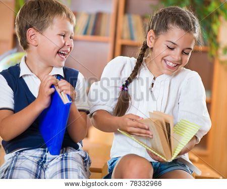 Two Happy Schoolchildren Have Fun In Classroom
