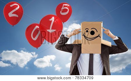 Anonymous businessman pointing to box against cloudy sky with sunshine