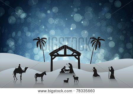 Nativity scene against blue abstract light spot design