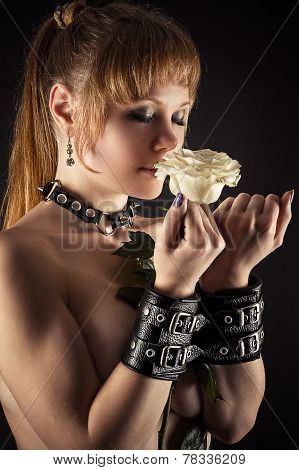 sexy woman slave in handcuffs with flower