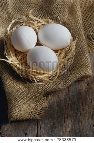 Fresh farm eggs on wooden background