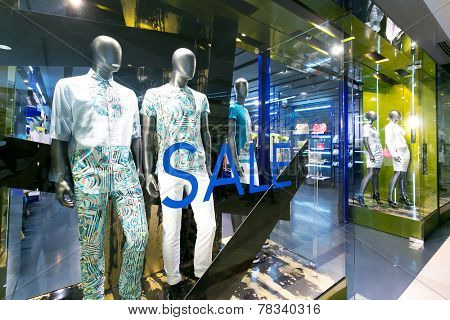 clothes shop display window and mannequins.