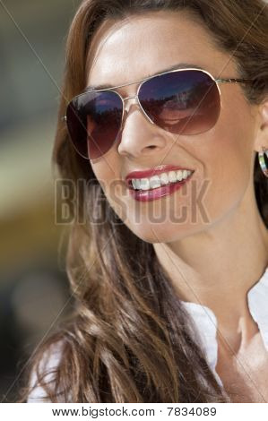Portrait Of A Beautiful Young Woman Wearing  Aviator Sunglasses