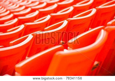 stadium, red seats on stadium steps bleacher with spot light pole
