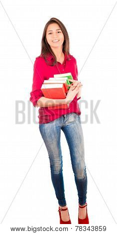 Young Latin Girl Holding Pile Of Books