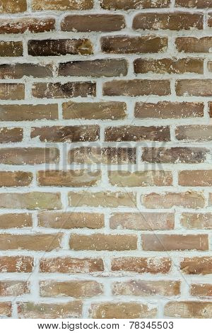 Brown Brick Wall With Concrete Fugues