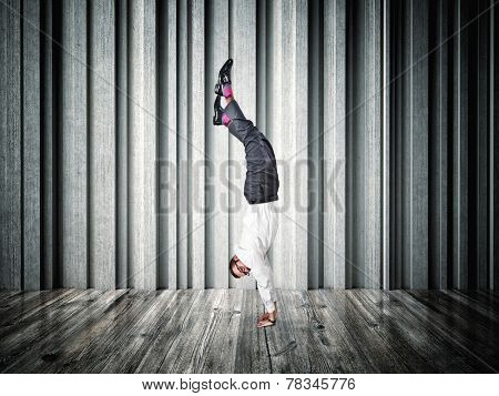 acrobat businessman and abstract background