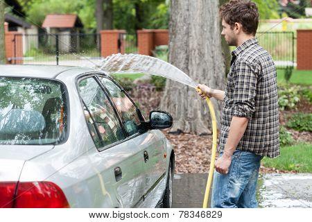 Man Perfusing His Car