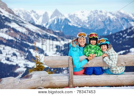 Two kids with mother enjoying winter vacations.
