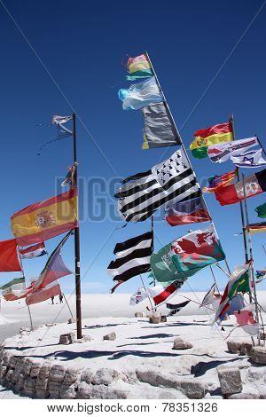 Flags in desert of Salar de Uyuni