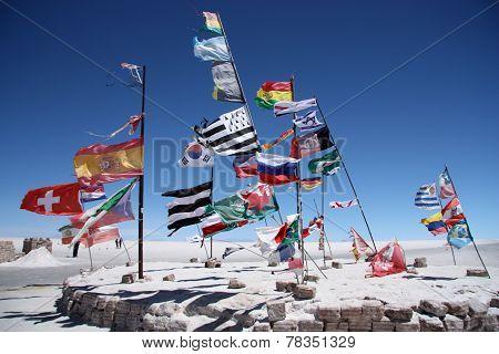 Flags of many countries in a salt desert of Salar de Uyuni