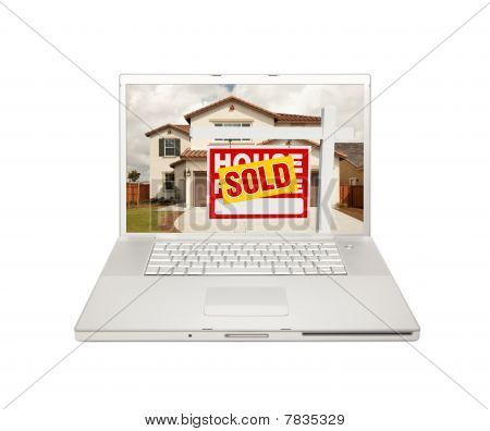 Sold For Sale Real Estate Sign On Laptop