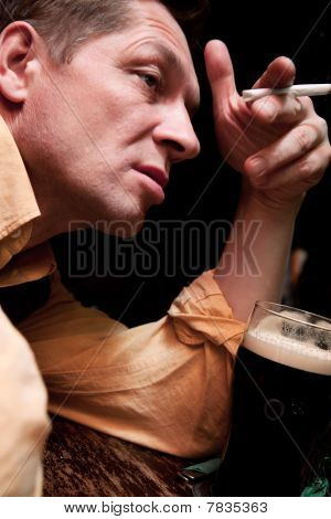 A Solitary Man Sits At A Bar