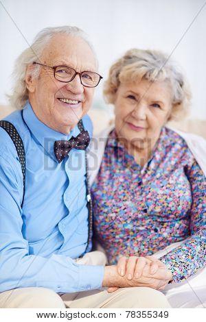 Elegantly dressed Caucasian senior couple