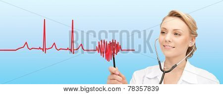 healthcare, people, medicine, cardiology and technology concept - smiling young female doctor with stethoscope listening to heartbeat cardiogram over blue background