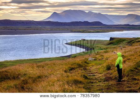 A hiker on Vatnsnes Peninsula in Northwestern Iceland
