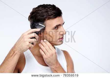 Man cuts himself over gray background