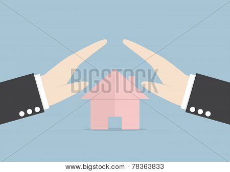Businessman Protect House By Hands
