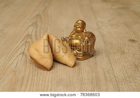 Buddha figurine with a fortune cookie