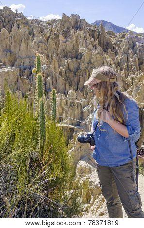 La Paz, Bolivia - Young blond tourist visiting Valle de la Luna (Moon Valley)