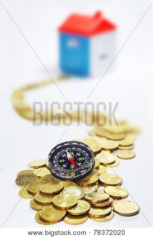 Gold Coins, Compass And House In White Background