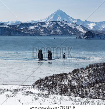 Three Brothers Rocks In Avachinskaya Bay And Viluchinsky Volcano (Kamchatka Peninsula)