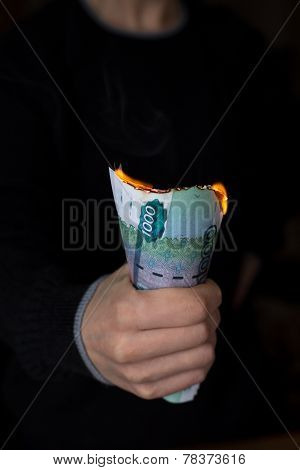 Pack Of Burning Rubles In Person's Hand