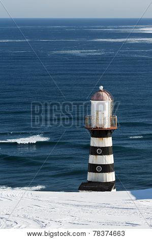 Lighthouse On Coast Of Pacific Ocean