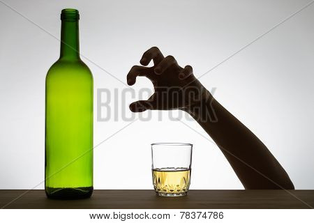 Hand Reaching For A Glass Of Wine