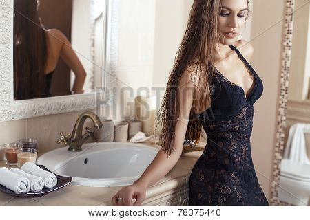 Sexy Woman With Long Hair In Lingerie Posing In Luxury Bathroom