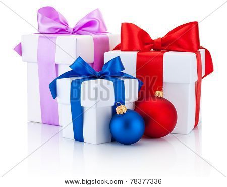 Three White Boxes Tied Red, Pink, Blue Ribbon Bow And Christmas Balls Isolated On White Background