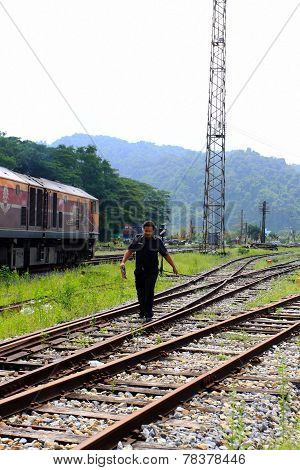 Thai Public Train And Railwayman At Railway Station In Thailand