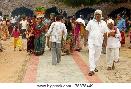 Hindu devotees carry Bonam to the temple in Golconda fort in Hyderabad,India
