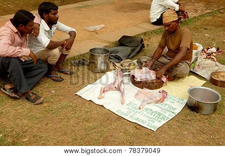 Hindu devotees make animal sacrifice during Bonalu festival to prepare bonam to offer goddess