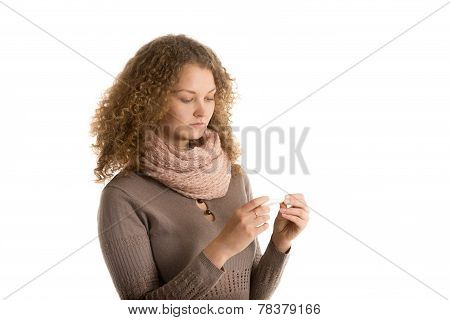 Girl Looks At Thermometer