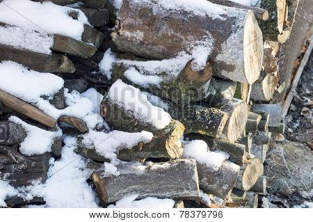 Firewood Cut Into Ridges Covered With White Snow