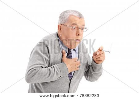 Senior man choking from the smoke of a cigarette isolated on white background