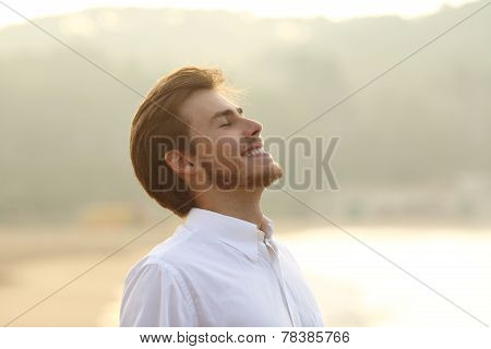 Happy Man Breathing Deep On The Beach In Vacation