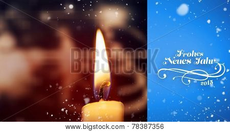 Snow falling against candle burning against festive background
