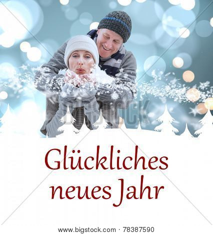 mature winter couple against gl�?�¼ckliches neues jahr