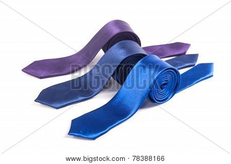 Colored Narrow Ties On An Isolated White Background