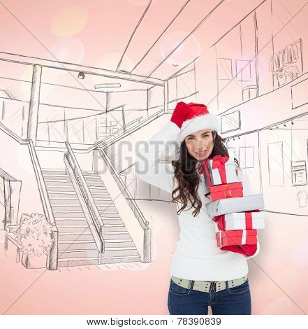 Stressed brunnette in santa hat holding gifts against twinkling blue and red lights