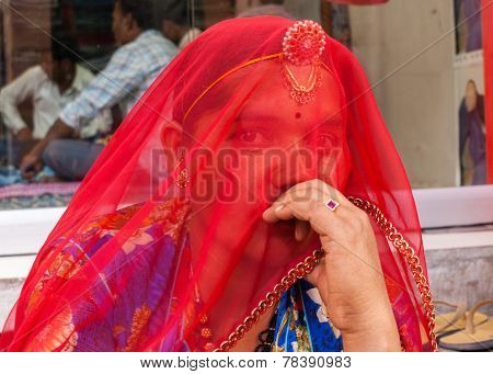 Woman Hides Her Face With Red Veil.