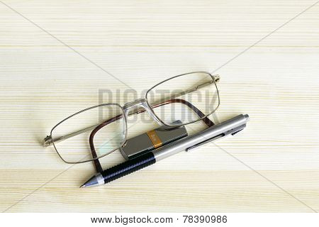 Glasses, Pen And Flash Drive