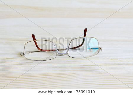 Men's Gilded Glasses On A Table Top