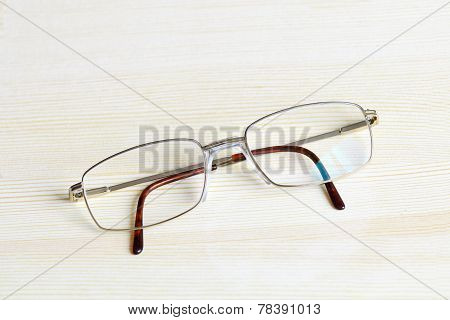 Gold Plated Mens Glasses On A Table Top