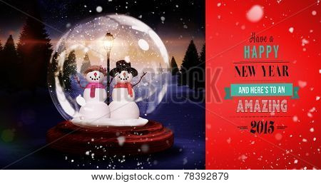 Snow falling against snowman and woman in a snow globe
